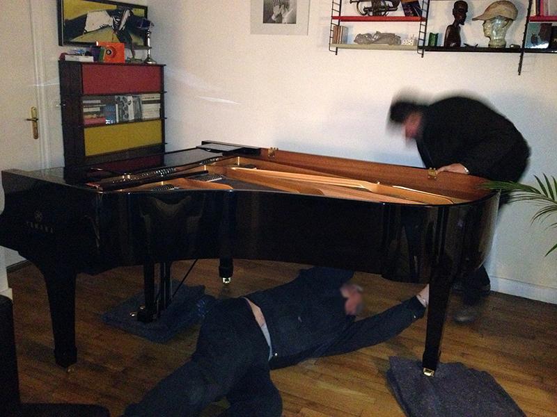 Déménagement d'un piano à queue